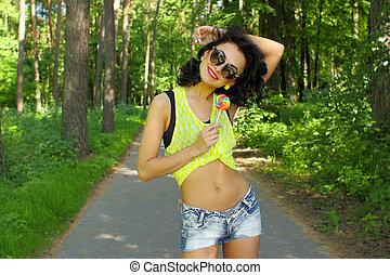 girl, sucer, mode, jean, été, t-short., dehors, porter, jeune, lifestyle., équipement, portrait, bleu, coloré, sucette, style pose, rigolote, sexy, rouges, lollipop.