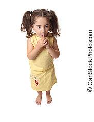 Girl sucking on a lollipop candy