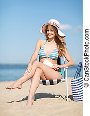 girl sunbathing on the beach chair - summer holidays and ...