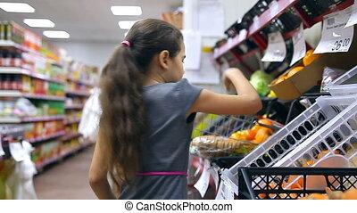 girl supermarket buy - girl teen in supermarket buy...