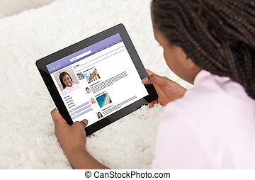 Girl Surfing On Social Site Using Digital Tablet