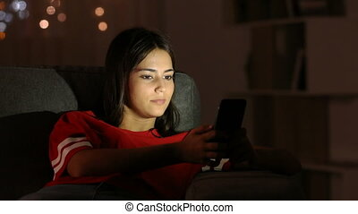 Girl surprised watching phone content in the night - Girl...