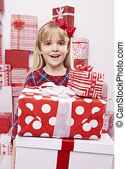 Girl surprised with pile of presents