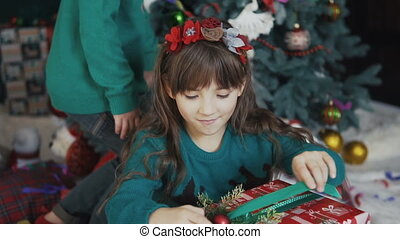 Girl Surprized by Gift Box - Kid girl holding surprize gift...