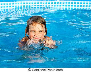 Girl swiming in a pool