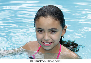 Girl swimming - Young girl swimming on blue swiming pool