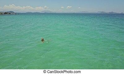 Girl Swims to Seacoast against Boundless Azure Ocean - girl ...