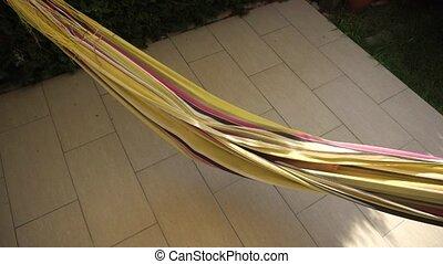Girl swinging and having fun in hammock - Funny little girl...