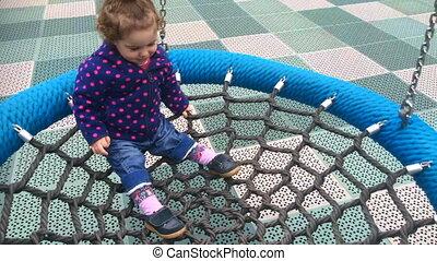 Girl swinging on a net swing