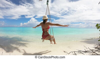 Girl Swinging on a Swing on Maldives, 4K.