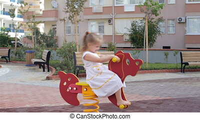 Girl swinging on horse