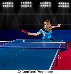 Girl table tennis player at sport hall