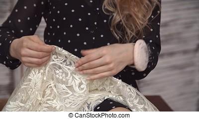 Girl tailor sews hands