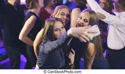 girl take selfie in a nightclub