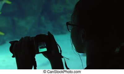 Girl takes pictures of colorful underwater world