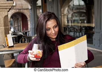 girl taking a drink at the bar