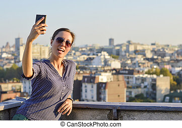 Girl taking a selfie at the rooftop
