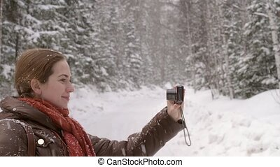 Girl taking a selfie under the snow