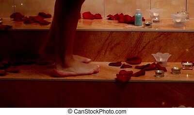 Girl taking bath with rose flower in spa. Dolly crane system.