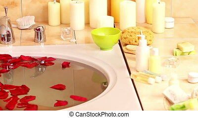 Girl taking bath with rose petals.