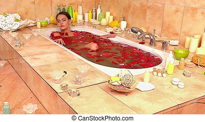 Girl taking bath with rose petals. Time lapse. - Pretty...