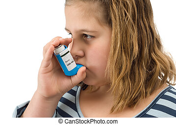Girl Taking Inhaler - A young child taking her asthma ...