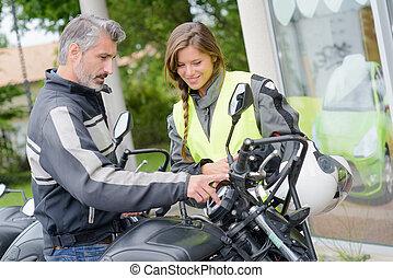 girl taking motorbike lessons