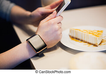 Girl taking photo of cheese cake with smart phone