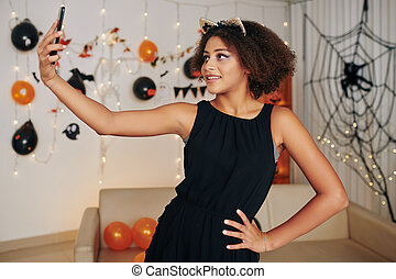 Girl taking selfie at Halloween party