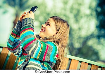 Girl Taking Smartphone Pictures