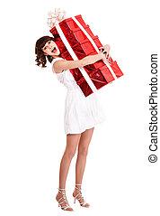 Girl taking stack  of gift box.