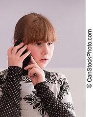 girl talk on telephone