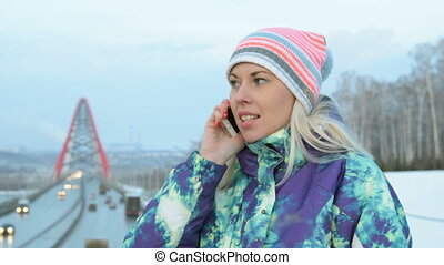 Girl talking on mobile phone in the city