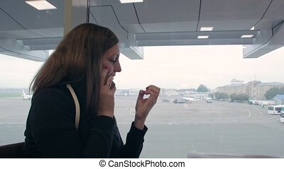 Girl Talking On Phone At Airport
