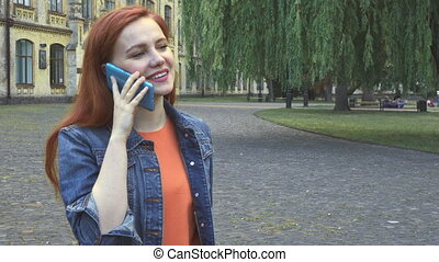 Girl talking on phone smiling and laughing