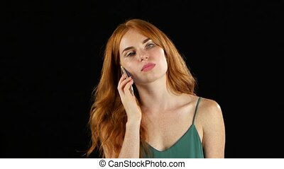 Girl talking on the phone. Black background