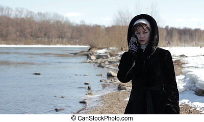 Girl talking on the Phone in the Winter