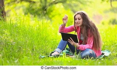 girl talking through the tablet