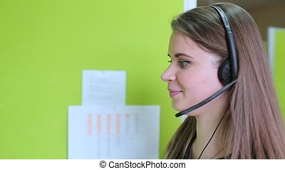 Girl talking with a client in a call center.