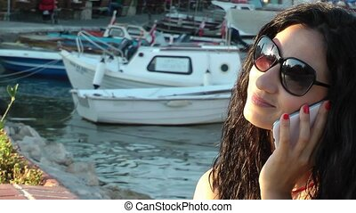 Girl Talking with Cellphone in dock