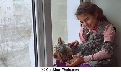 girl teen and dog sitting on a pet window sill windowsill - ...