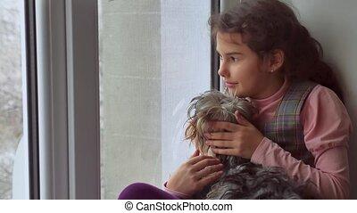 girl teen and dog sitting on a window pet sill windowsill - ...