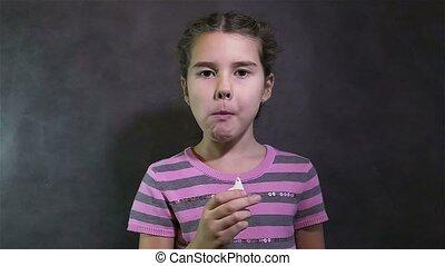girl teen eating crab sticks on gray background - girl teen...