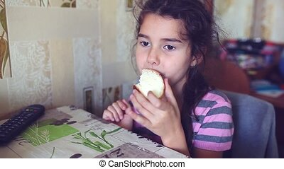 girl teen eats bread with butter tea drinkers breakfast -...