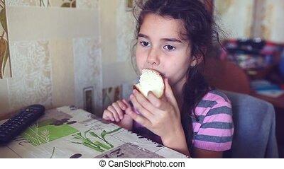 girl teen eats bread with butter tea drinkers breakfast -...