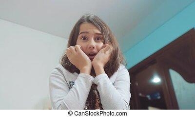 girl teen opens gift surprise emotions joy. people,...