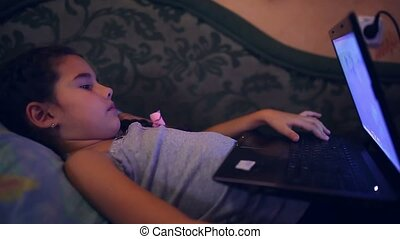 girl teen playing laptop lifestyle lying on sofa computer...