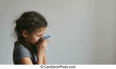 girl teen sneezing flu into a handkerchief influenza virus -...