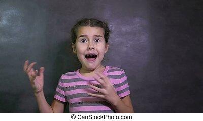 girl teen surprise fear of terror fright big eyes studio slow motion