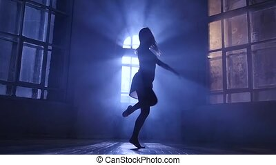Girl teenage dance moonlight penetrates through window. Silhouette, slow motion